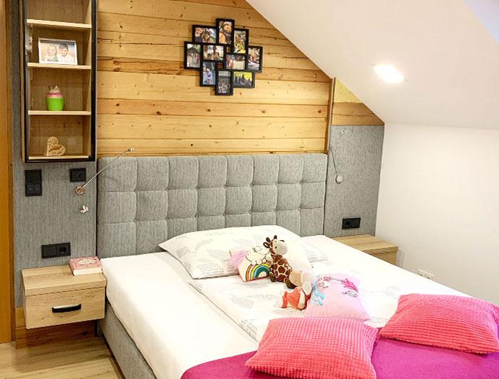 Jugendschlafzimmer Ansicht eines Boxspringbettes mit Wandverbau